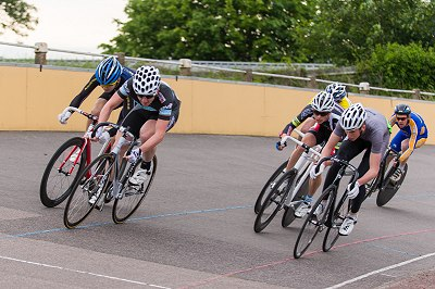 Matt Gittings of AW Cycles comes round Louis Magnani to win the trackcycling 10 lap scratch