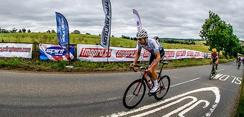 Stephen Orbie forcing the pace up the finish hill with one  lap to goSML